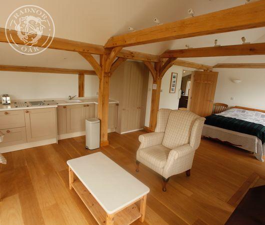 Exposed oak beams in a Radnor Oak holiday lodge