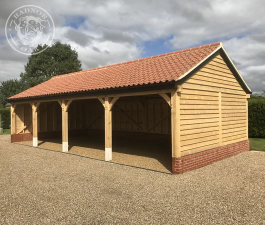 Four bay open fronted carports by Radnor Oak