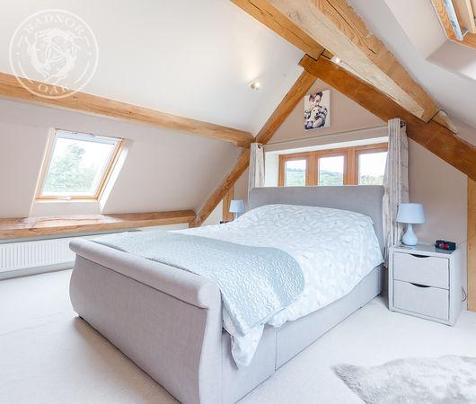 Radnor Oak bedroom in an oak framed garden cottage.