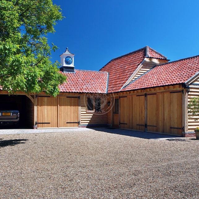 Large oak framed garage complex with Pan tiles